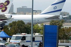 An El Al airplane with a Star of David on its tail sits on the tarmac at the international terminal