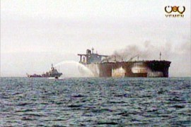 The French-flagged supertanker Limburg burns in the Gulf of Aden early on Monday as Yemeni and French experts prepare to investigate an explosion the owners fear was caused by a terror attack October 7, 2002.  The Yemeni government has ruled out an attack similar to the October 2000 suicide assault on the U.S. destroyer USS Cole in Aden port, saying a fire aboard the Limburg caused the blast. REUTERS/RTV