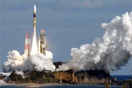 Japan's next generation H-2A rocket lifts off from Tanegashima Space Center, a small tropical Japanese island about 1,000 km (620 miles) southwest of Tokyo, on December 14, 2002. Japan successfully launched the space rocket on Saturday, carrying its first foreign satellite — from Australia — and moving a step closer to winning international trust crucial for commercialising its trouble-plagued satellite launch business.      JAPAN OUT    NO RESALES    NO ARCHIVES   REUTERS/Kyodo