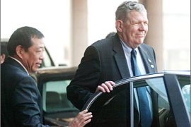 U.S. Assistant Secretary of State James Kelly (R) enters a limousine as he leaves for talks with his North Korean counterpart in China's capital of Beijing April 24, 2003. Kelly headed on Thursday into a second day of talks with North Korean and Chinese officials aimed at paving the way to defusing tensions over Pyongyang's suspected nuclear weapons programme.  REUTERS/Wilson Chu