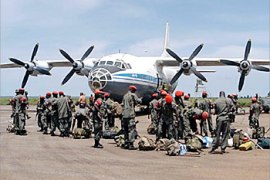 F__The last group of Uganda People's Defence Forces (UPDF) arrive at Entebbe airbase 06 May 2003 following their withdrawal, from Ituri Province Eastern  DR Congo where they have been for the past three years.  AFP PHOTO/PETER BUSOMOKE