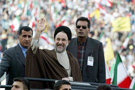F_Iranian President Mohammad Khatami salutes a crowd of some 50,000 people 13 May 2003 before delivering a speech at Beirut's Sports City. Khatami spoke out against any escalation of tensions in the Middle East and against anything that might contribute to instability in the region. His three-day visit to Lebanon was cloaked under the theme of moderation and Lebanese papers portrayed his visit as a message to Hezbollah to keep a low profile.  AFP PHOTO/Ramzi HAIDAR