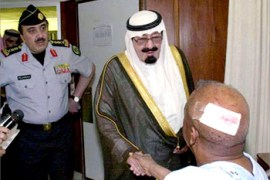 "Saudi Arabian Crown Prince Abdullah (C) visits an injured western man at a hospital in Riyadh  in this picture taken May 13, 2003.  The bombings in the world's largest oil exporter delivered a bloody reminder to the Bush administration that despite its successful overthrow of Saddam Hussein in neighbouring Iraq, its ""war on terror"" was far from over. REUTERS/Saudi Press Agency"