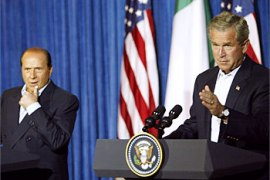 F_Italian Prime Minister Silvio Berlusconi (L) and US President George W. Bush (R) conduct a joint press conference at Bush's Prairie Chapel Ranch 21 July 2003 in Crawford, Texas.  Bush wrapped up talks with Berlusconi, facing a trio of deepening foreign policy crises in Liberia, Iraq and North Korea.   AFP Photo/Paul J. RICHARDS