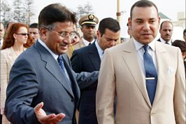 F_Pakistani President Pervez Musharraf (2D L) is greeted by Moroccan King Mohammed VI (R) accompanied by his wife, Princess Lalla Salma (L), at the royal palace at Rabat 17 July 2003. Musharraf was officially visiting Morocco after Tunisia and Algeria on a North African tour.