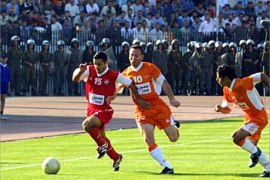 f_Syrian Ittihad player Mohammad Boutaqa (L) is followed by al-Wehdah players Maher Moustafa (C) and Ghassan Matouq during the final game of the  President cup, 04 July 2003, in Damascus. Al-Wehdah beat al-Ittihad 5-3. AFP PHOTO/ Louai BESHARA