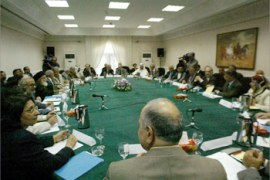 The 25-member council are seen meeting at the former Ministry of Military Industry in central Baghdad 13 July 2003. Iraq's first national executive body since US-led forces ousted Saddam Hussein and his Baath Party more than three months ago gathered in Baghdad for a landmark meeting which falls almost 35 years to the day after the Baath Party regime came to power in 1968.