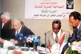 F: First Vice President Of Sudan Ali Osman Taha (2nd R) and Egyptian Prime Minister Atef Ebeid (2nd L) sign a 19 agreements and protocols on issues concerning trade, economy, information and infrastructure in Khartoum 20 July 2003. The joint Sudanese-Egyptian High Commission on Sunday underlined the need for peace and reconciliation in Sudan in a way that guarantees national unity, independence and territorial security.