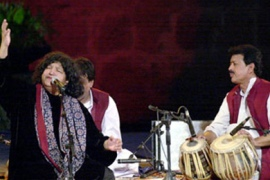 Pakistani famous singer Abida Parveen (L) performs on stage late 14 August 2003 during the 39th Carthage cultural festival, outside Tunis