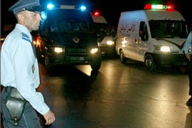 afp – Police escort the vans containing the 34 Islamists, including French Pierre Robert, 18 September 2003 as they leave the Rabat