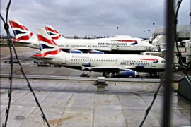 f /  Steel fencing and razor wire protects British Airways planes parked at Heathrows Terminal four in London, 31 January 2004. British Airways has cancelled flights to both Washington and
