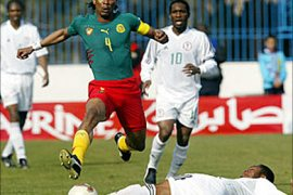 F/Cameroon's defender and captain Rigobert Song (C) is tackled by Nigeria's  Austin Ejide (ground),
