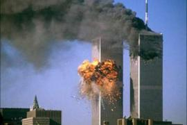 The World Trade Center south tower (L) burst into flames after being struck by hijacked United Airlines Flight