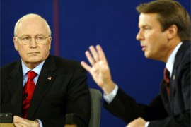 Democratic vice-presidential candidate John Edwards (R) flashes four as US Vice-President Dick Cheney