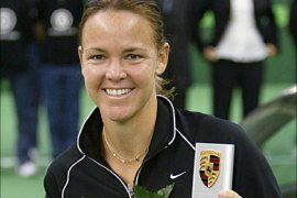 Second seed Lindsay Davenport of the US poses with her trophy after defeating world number one Amelie Mauresmo of France in the WTA Grand Prix tennis tournament in Filderstadt, 10 October 2004. Mauresmo withdrew with a recurring left-thigh strain, handing a 45th career title and a luxury Porsche car to Davenport.   AFP PHOTO/OLIVER LANG    GERMANY OUT