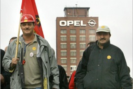 REUTERS – Workers of General Motors' German unit Adam Opel AG gather in Ruesselsheim near Frankfurt to protest against
