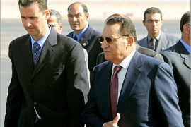 AFP  – Syrian president Bashar Al-Assad (L) is lead by his Egyptian counterpart Hosni Mubarak (R) moments after his arrival to