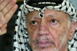 f_(FILES)-Palestinian leader Yasser Arafat is seen at his office in the West Bank city of Ramallah 13 August 2003. Arafat died 04 November 2004 in a hospital in France, Israeli private television and military radio reported.      AFP PHOTO/JAMAL ARURI