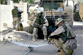 AFP  – US soldiers prepare a drone during an operation for search of weapons and possible insurgents in al-Mafraq district in the city of Baquba, northeast of Baghdad, 29 April 2005. At