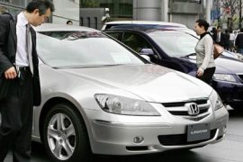 AFP  – People look at cars of Japan's third-ranked carmaker Honda Motor in front of the company's headquarters in Tokyo, 26 April