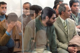 f/Some of the suspected members of Al-Qaeda wait for the beginning of Europe's biggest trial against suspected members of the Al Qaeda network at Madrid's High court, 22 April 2005.