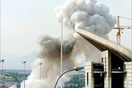 REUTERS/  A column of smoke raises beside Madrid's Olympic stadium after a car bomb explosion June 25, 2005. A bomb exploded in the car park of a sports stadium in Madrid on Saturday