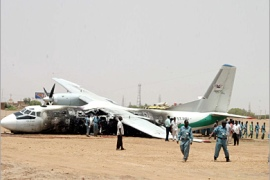 AFP  – Rescue workers gather around a Sudanese passenger plane which crashed shortly after take-off from Khartoum airport and caught fire 02 June 2005. Five people were killed and