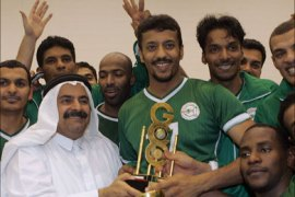 afp – Saudia Arabia's players accept a trophy from Sheikh Saud bin Ali, vice-president of the Qatari Olympic Committee, after their final match against Qatar