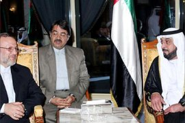 Picture released by the Emirati news agency WAM shows UAE President Sheikh Khalifa bin Zayed Al-Nahyan meeting Iranian Foreign Minister Manouchher Mottaki in Al Ain 05 October 2005. Mottaki put off a planned visit to Saudi Arabia after the two countries publicly rowed over the situation in Iraq.     AFP PHOTO/WAM