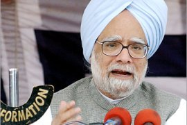AFP /  Indian Prime Minister Manmohan Singh addresses a  press conference at the military airport in Srinagar 11 October 2005, after he toured the Indian Kashmir earthquake affected