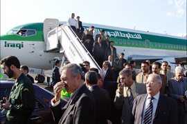 r_Passengers disembark an Iraqi airways plane after landing at Tehran's Mehrabad International airport