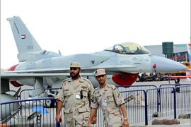 AFP  – Emirati army exhibitors are seen prior to the opening of the Dubai Air Show 19 November 2005. Dubai will host the major air exhibition amid relentless competition by the world's jet