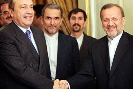 r_Secretary of Russia's Security Council Igor Ivanov (L) shakes hand with Iranian Foreign Minister