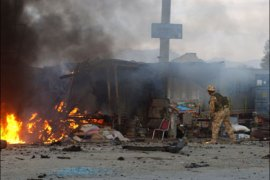 afp – Soldiers of the International Security Assistance Force (ISAF) search for casualties at the scene of a second apparent suicide car bomb which exploded in Kabul
