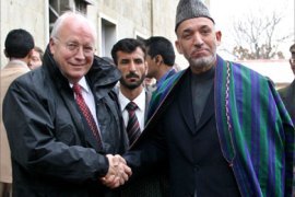 Afghan President Hamid Karzai (R) shakes hands with the U.S. Vice President Dick Cheney during a meeting at the Afghan presidential palace in Kabul December 19, 2005. Warlords, former communists,