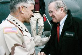 r_U.S. Secretary of Defense Donald Rumsfeld (R) shakes hands with General George Casey, U.S.