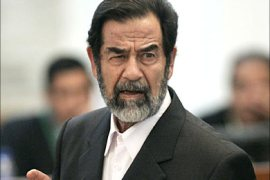 f_Former Iraqi President Saddam Hussein glares at prosecutors as he speaks at his trial
