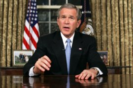 r – U.S. President George W. Bush delivers a speech about U.S. involvement in Iraq from the Oval Office in the White House in Washington December 18, 2005