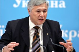 Ukrainian Prime Minister Yuri Yekhanurov gestures during a news conference in Kiev, December 20, 2005. Ukrainian President Viktor Yushchenko linked tough talks with Russia on gas supplies to suggestion that the Kremlin should pay more rent to keep its Black Sea Fleet in Ukraine's Crimea peninsula.