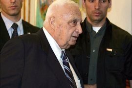 f_Israeli Prime Minister Ariel Sharon arrives at his offices in Jerusalem 12 December 2005. The defection
