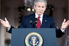 REUTERS  /U.S. President George W. Bush answers a question during a news conference in the East Room of the White House in Washington December 19, 2005. Bush vowed on Monday