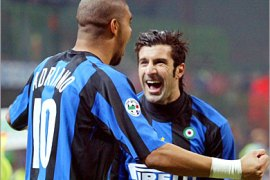 . AFP-   Inter Milan's forward Adriano of Brazil (L) celebrates with midfielder Luis Figo of Portugal after scoring a goal against Empoli during their  serie A football match Inter-Empoli at
