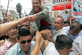 afp – Peruvian presidential candidate and ex-military man Ollanta Humala, greets his supporters in Lima, December 30, 2005. According to recent polls