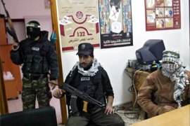 Palestinian gunmen occupy the offices of the central elections commission in the southern Gaza Strip city of Rafah, 04 January 2006.