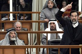 f_Former Iraqi President Saddam Hussein chastises the court after his half brother, Barzan Ibrahim