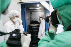 afp – Iranian photographers take pictures of a container of radioactive uranium, 'yellow cake', that was sealed by the International Atomic Energy Agency, at the Isfahan Uranium