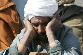 f_An Egyptian man waiting for the news about his relatives in Safaga  port in 04 February 2006. More than
