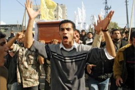 Mourners shout anti-Israel slogans during the funeral procession 05 February 2006 in Gaza City of three Palestinian militants killed in an Israeli air strike yesterday. Hamas,