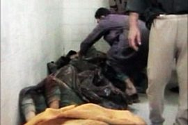 r_An image taken from footage shot on November 19, 2005 shows bodies in a morgue after an incident in Haditha, about 140 miles (220 km) northwest of Baghdad.  U.S. Marines could face criminal charges, possibly including murder, for their involvement in the deaths of up to two dozen Iraqi civilians in Haditha last November, a defense officials said on May 26, 2006.