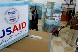 f_USAID employees are seen at the CARE international warehouse in the West Bank town of Ramallah, 10 May 2006,